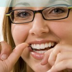 Flossing teeth for oral health